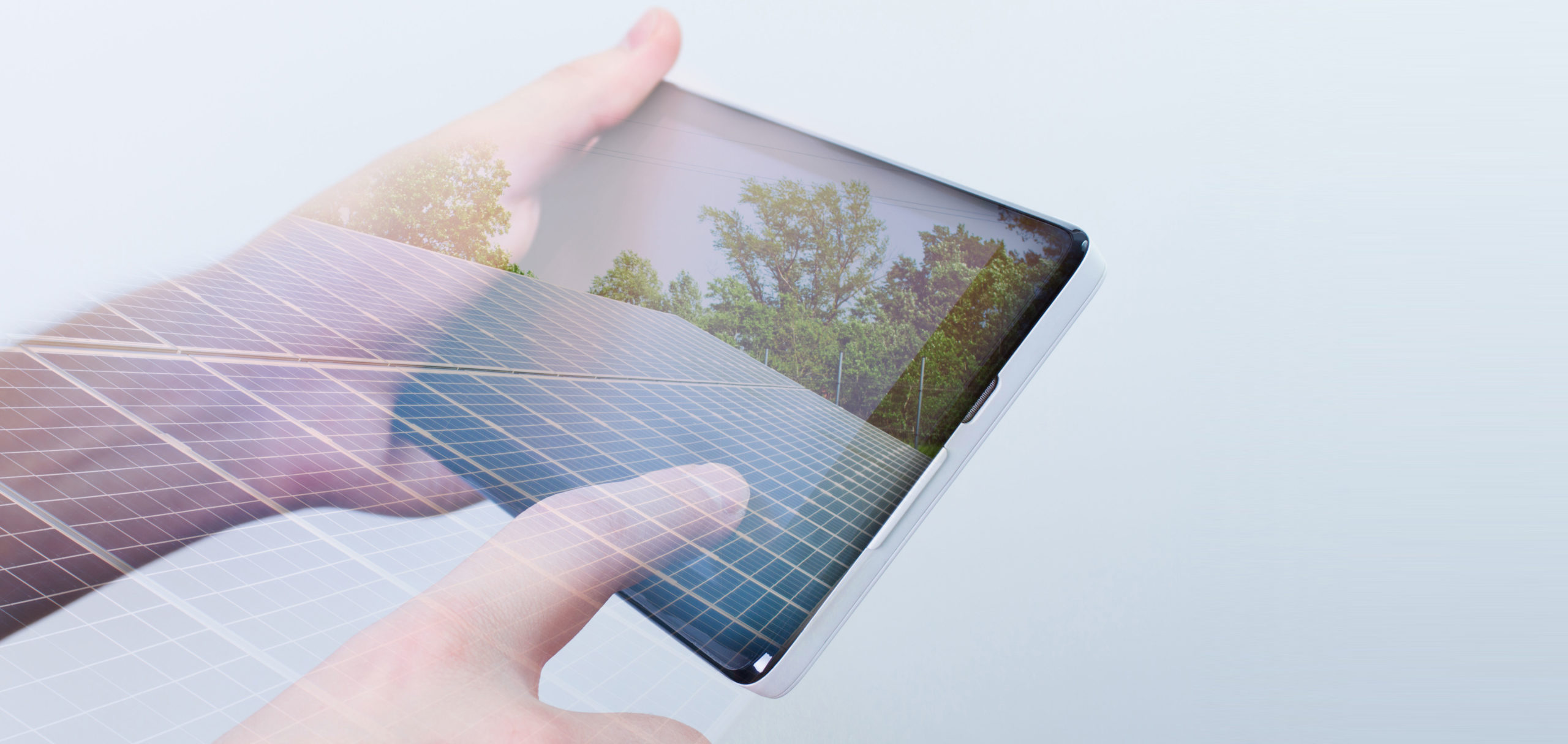 double-exposure-hand-holding-digital-tablet-solar-panels-on-screen1